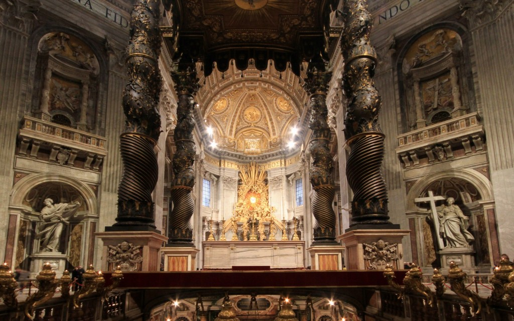 Inside St. Peter's Basilica - Bernini's Baldacchino. This bronze canopy is located directly under the dome of St. Peter's and is supposed to mark St. Peter's tomb underneath. Claimed to be the world's largest piece of bronze.